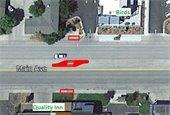 Google image showing median with crosswalk near Birds egress