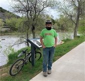 Owen standing by his bike on the Animas River Trail