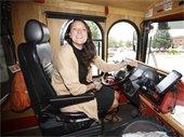 Sarah Hill driving a bus.