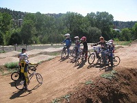 Belvins and Rocket, youth on bicycles on dirt track