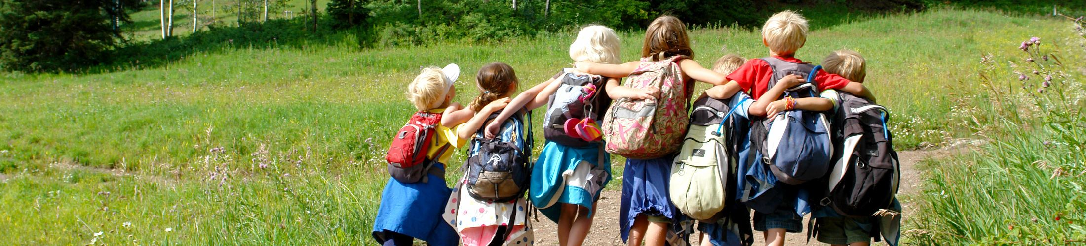 photo of children hiking in the spring