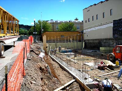 Construction of a building with only the foundation and rebar started.