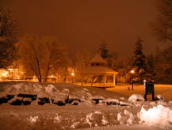 Snow covered park and gazebo